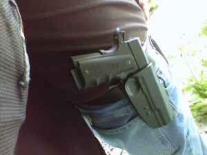 The author with his 1911 .45 holstered.