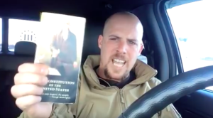 An outraged Jon Ritzheimer wants you to see his pocket Constitution.